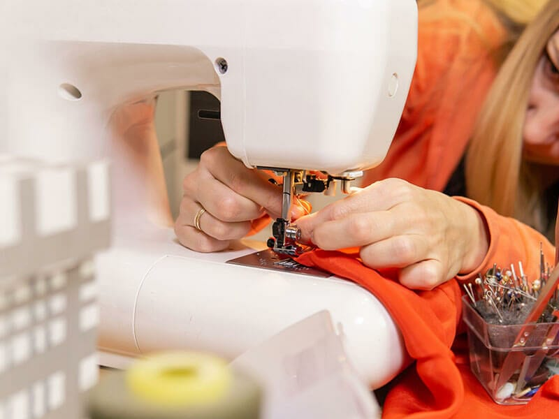 Seamstress Woman Changes Needle